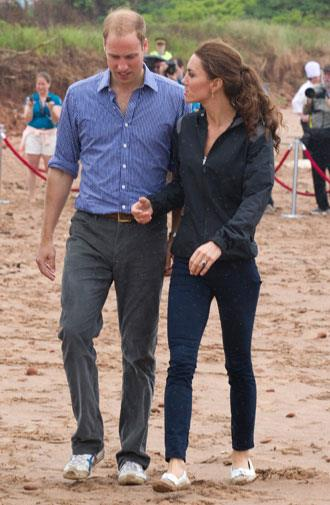 Chatting as they strolled along the beach in Canada in 2011.