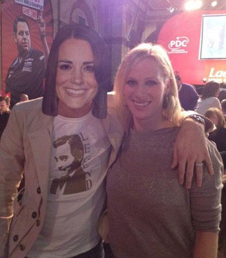 Zara Phillips with someone wearing a Kate Middleton mask.