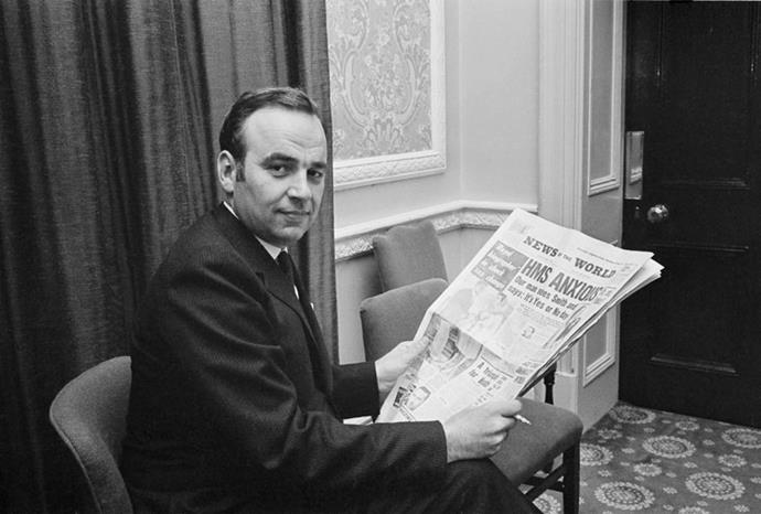 Rupert with his beloved *News of the World* paper in 1968.