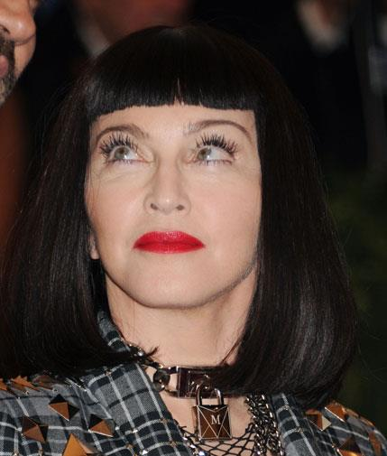 Pulling an unusual face at the Met Ball in May 2013.