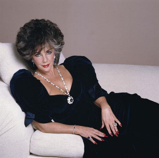 Elizabeth Taylor wearing the necklace, given to her by Richard Burton, in 1988.