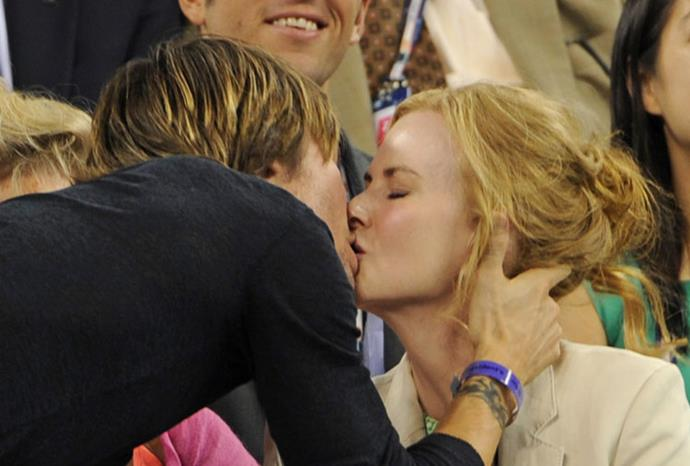 Nicole and Keith enjoy a kiss at the tennis.