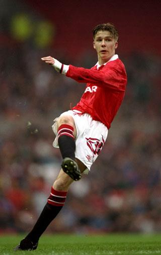 A baby-faced Beckham playing for Manchester United Youth in 1993.