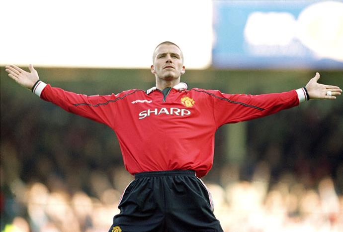 Beckham celebrates after a win for Manchester United in 2000.