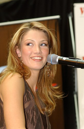 A baby-faced Delta singing in 2003.