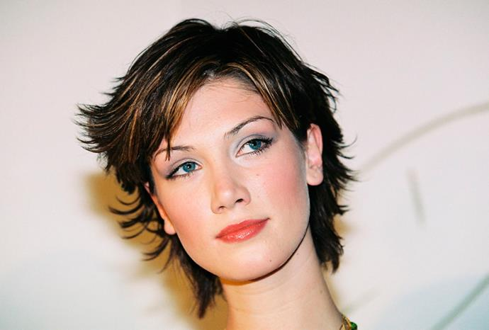 Delta sported a cropped hairstyle after her cancer treatment in 2004.