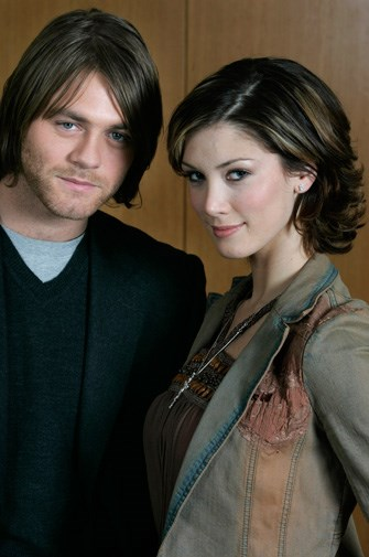 Dark-haired Delta with new beau Brian McFadden in 2005.