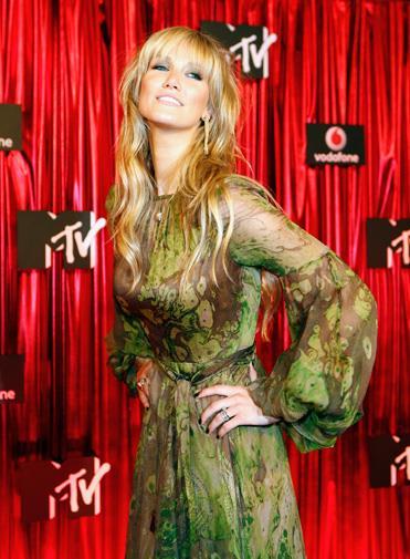Delta strikes a fashion-forward pose at the MTV Australia Awards in 2009.