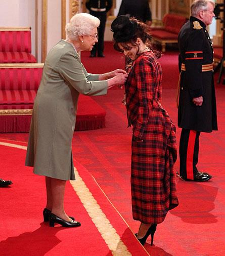 The Queen gives Helena some style tips. Just kidding, she's receiving the CBE medal.