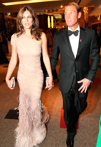 Shane and Liz attend a breast cancer gala in 2012.