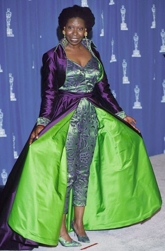 Whoopi Goldberg in lime green and purple in 1993.