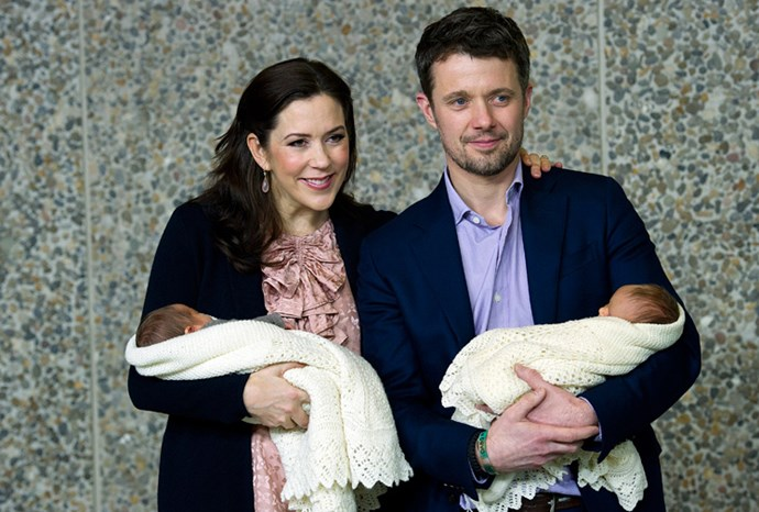 Mary and Frederik leave hospital with their newborn twins.