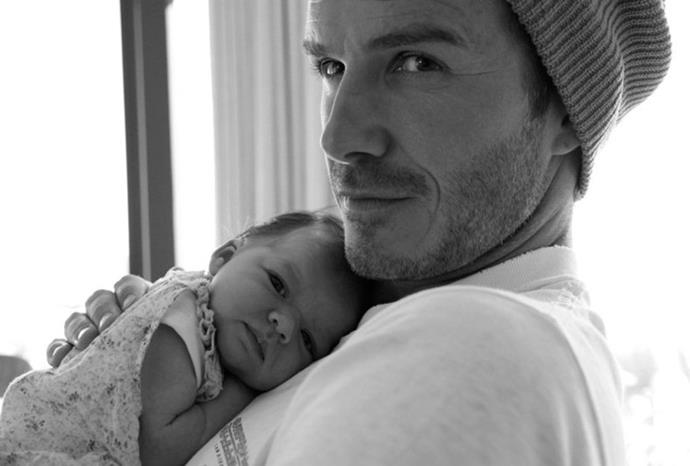 Victoria Beckham tweeted this photo of David with baby Harper.