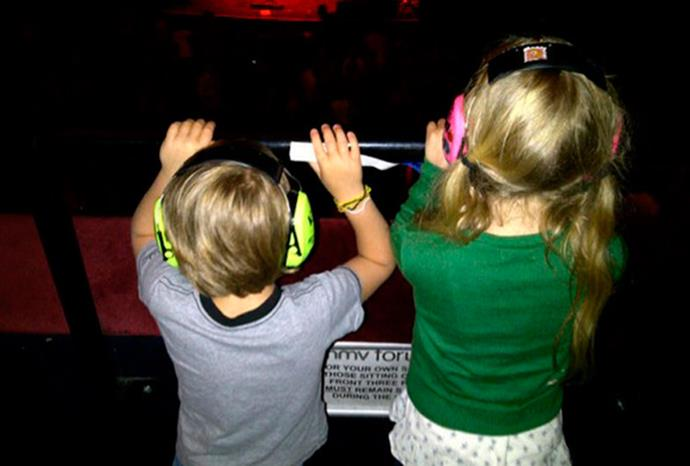Gwyneth Paltrow tweeted this pic of Apple and Moses at a Coldplay concert.