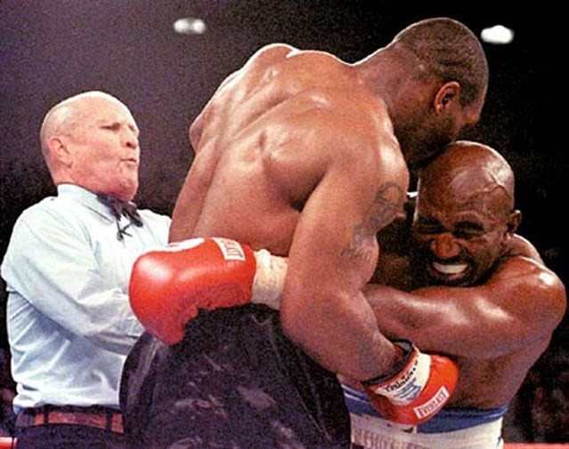 Mike Tyson illegally bit off a piece of Evander Holyfield's ear in 1997.