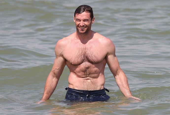 Hugh looking very muscular in St Tropez in July 2011.