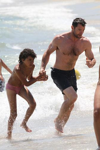 Hugh and his adopted son Oscar in St Tropez.