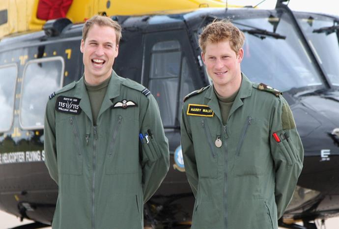 The boys pose in front of a helicopter at RAF Shawbury in 2009.