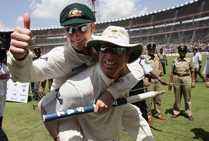 Shane Warne gives Michael a piggyback in 2004.