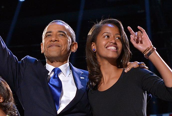 Barack and Malia celebrate his victory in Chicago last night.
