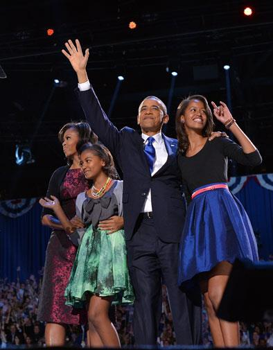 Malia is nearly as tall as her father, and the image of her mother.
