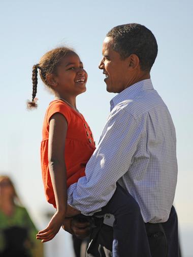 Barack cradles Sasha in November 2008.