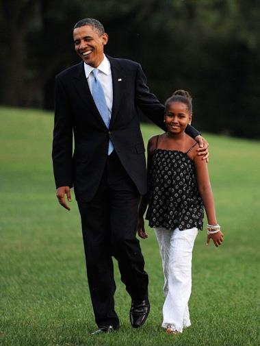 Barack and Sasha arrive back at the White House in August 2010.
