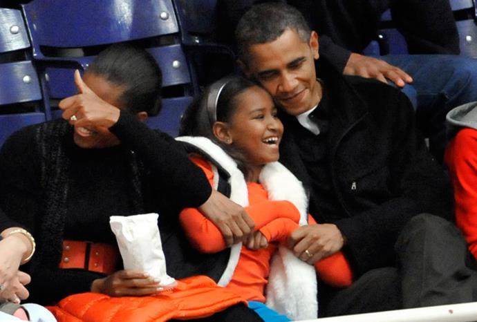 Barack, Michelle and Sasha at a basketball game in November 2010.