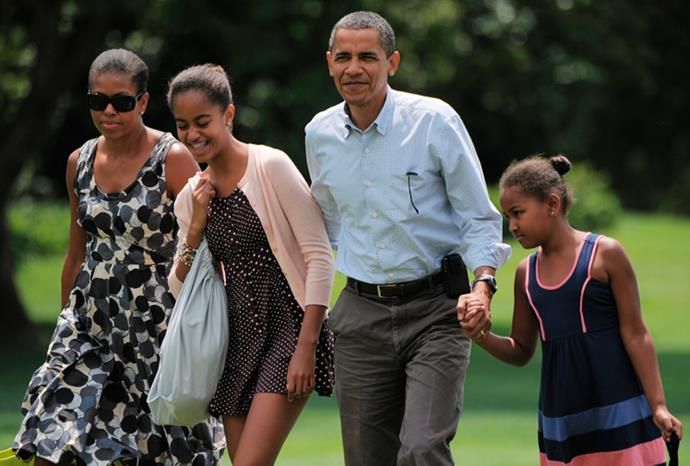 The Obamas arrive back at the White House in July 2010.