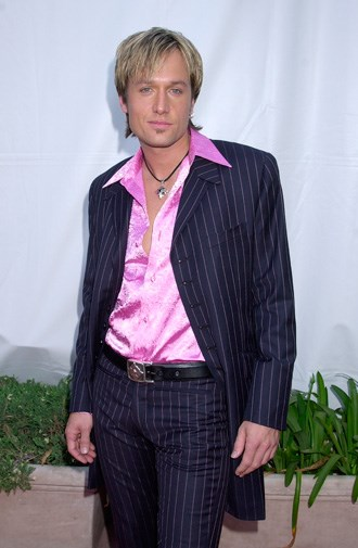 Looking bored in pink satin in 2001.