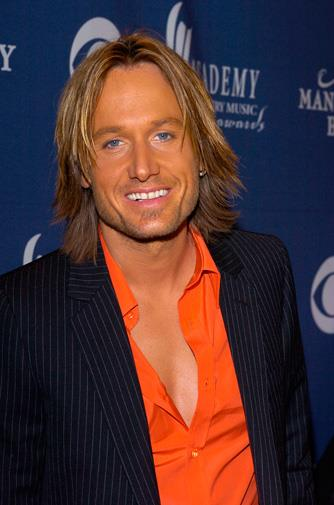 Keith's tan was as orange as his shirt in 2004.