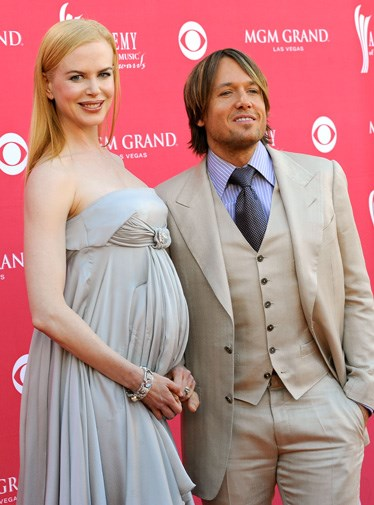 Keith looking dapper with pregnant wife Nicole in 2008.