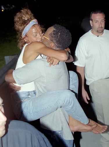 Whitney greets Bobby as he is released from jail in 2000.