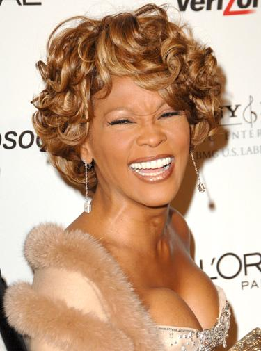Whitney looking happy post-divorce in 2007.