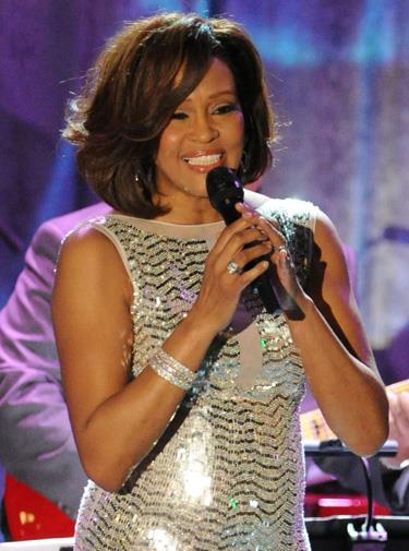 Whitney performing at the 2011 Grammy Awards.