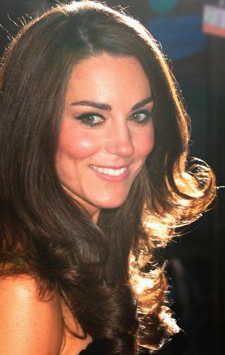 Kate wore her hair in her trademark loose waves.