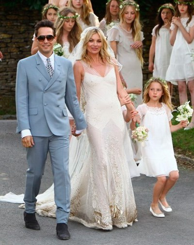 Kate Moss in her John Galliano wedding gown in July.