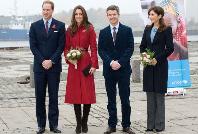 William, Kate, Mary and Frederik chat outside the UNICEF warehouse.