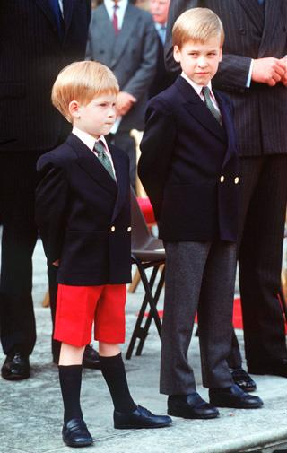 Prince William watches over Harry at the youngest's princes first official event in London in 1989.
