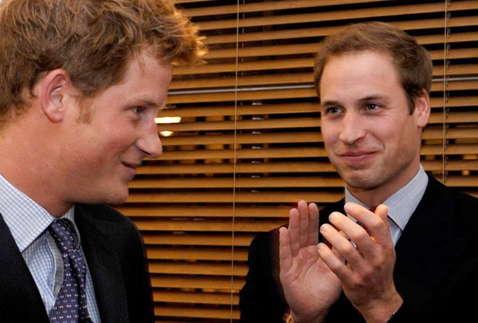 William looks proudly at his younger brother at a charity reception in 2009.