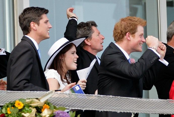 Eugenie and Prince Harry cheer for their horses at Derby Day in June.