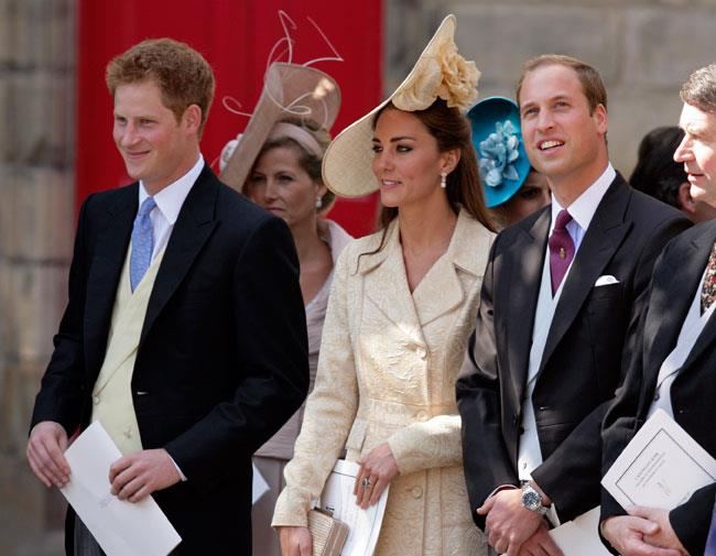 Prince Harry, Kate Middleton and Prince William wait for the bride to arrive.