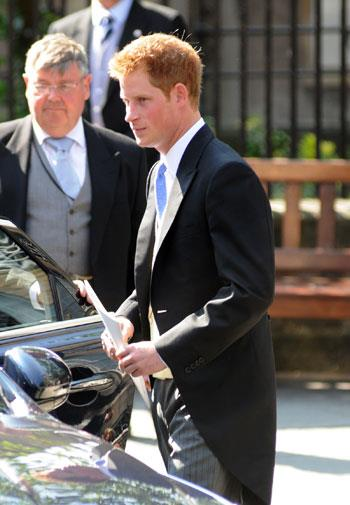 Harry heads to the reception at the Palace of Holyroodhouse.