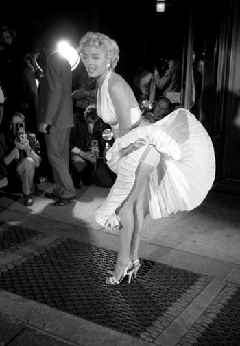 Marilyn Monroe filming her famous scene in *The Seven Year Itch* in 1954.