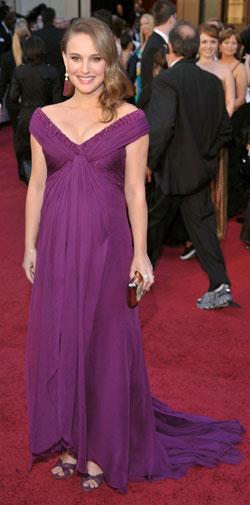 Best Actress winner Natalie Portman shrouded her growing baby bump in Rodarte