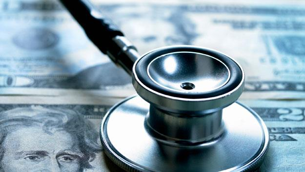 Stethoscope and currency, Getty Images