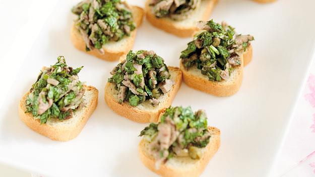 "**[Steak with salsa verde on mini toasts](https://www.womensweeklyfood.com.au/recipes/steak-with-salsa-verde-on-mini-toasts-9276|target=""_blank"")**  Piquant and full of fresh flavours, salsa verde turns these mini-toasts topped with sliced steak into a fabulous cocktail party platter."