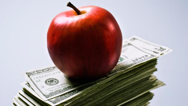 apple and money, getty images