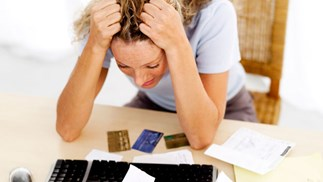 distressed woman with credit cards
