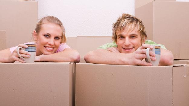 young couple with cardboard boxes, thinkstock